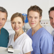 Portrait American medical team on hospital ward — Stock Photo #11888737