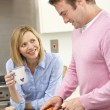 Royalty-Free Stock Photo: Mature couple preparing meal in domestic kitchen