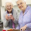 Stock Photo: Senior women preparing meal together