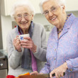 Senior women preparing meal together — Stock Photo #11888790