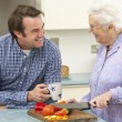 Mother and adult son preparing meal together — Stock Photo #11888791