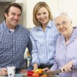 Senior woman and family preparing meal together — Stock Photo #11888798