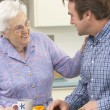 Mother and adult son preparing meal together — Stock Photo