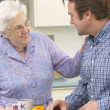 Mother and adult son preparing meal together — Stock Photo #11888799