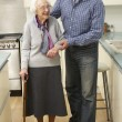 Mother and adult son in kitchen - Stock Photo