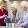 Senior women at home with carer — Stock Photo #11888823
