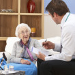 UK GP visiting senior woman at home — Stock Photo #11888862