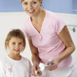 Mother and daughter cleaning teeth in bathroom — Stock Photo