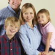 Studio Shot Of Relaxed Family - Stock Photo