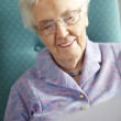 Senior Woman Relaxing In Chair Reading Letter — Stock Photo #11889261