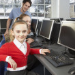 Stock Photo: Girls using computers in school class
