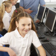 Foto Stock: Girl in school class smiling to camera