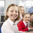 Girls and teacher in school class - Stock Photo