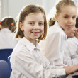 Foto Stock: Girls in school class looking to camera