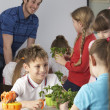 Children learning about plants in school class - Stock Photo