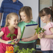 Girls learning about plants in school class — Stock Photo