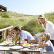 Family on vacation eating outdoors — Stok fotoğraf
