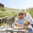 Family on vacation eating outdoors — Stock Photo #11889516