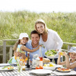Family on vacation eating outdoors — Stock Photo #11889518