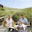Family on vacation eating outdoors — Stock Photo #11889520