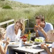 Family on vacation eating outdoors — Stock Photo #11889525