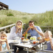 Family on vacation eating outdoors — Stock Photo #11889527