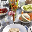 Outdoor table set for breakfast - Stock Photo