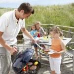 Family on vacation having barbecue — Stock Photo