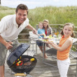 Family on vacation having barbecue - Stockfoto