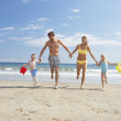 Family on beach vacation - Stock Photo
