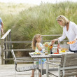 Family on vacation eating outdoors — Stock Photo #11889610