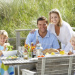 Stock Photo: Family on vacation eating outdoors