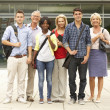Stock Photo: Mixed group of students outside college