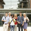 Royalty-Free Stock Photo: Mixed group of students outside college