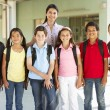 Pre teen schoolchildren with teacher — Stock Photo #11889812