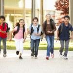 Schoolchildren at home time — Stock Photo