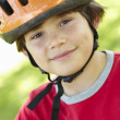 Stock Photo: Boy wearing cycling helmet