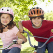 Boy and girl riding bikes — ストック写真