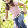 Girl riding bike — Stock Photo