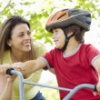 Boy on bike with mother — Stok fotoğraf