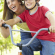 Stock Photo: Boy on bike with mother