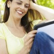 Woman using tablet outdoors — Stock Photo