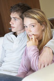 Nervous Looking Teenage Girl Sitting On Sofa At Home With Boyfri — Stock Photo