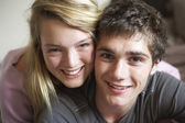 Romantic Teenage Couple Smiling At Camera — Stock Photo