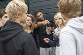 Group Of Threatening Teenagers Hanging Out Together Outside Drin — Stock Photo