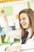 Teenage Female Student Answering Question In Classroom — Foto Stock