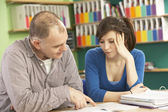 Teenage Student In Classroom With Tutor — Stock Photo