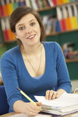 Teenage Female Student In Working In Classroom — Stock Photo