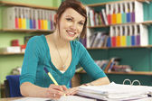 Teenage Female Student In Working In Classroom — Stockfoto