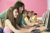 Teenage Students In IT Class Using Computers With Tutor — Stock Photo